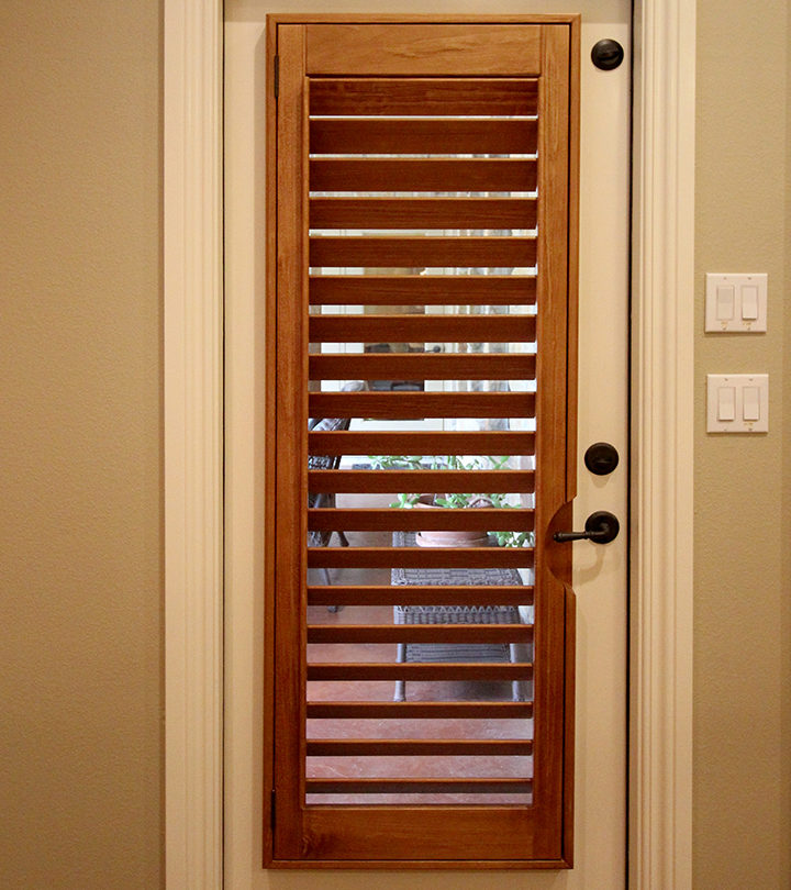 patio door with wood shutters framed on glass in Austin TX home
