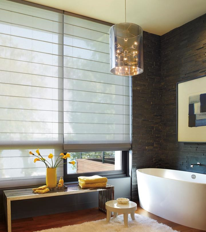 modern bathroom with floor to ceiling window treatments as shades on large windows in Austin TX