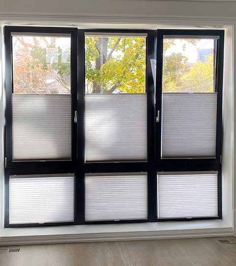 light filtering shades on tilt turn windows with black frames in Austin TX
