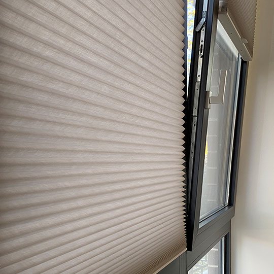 close up to tilt turn windows with gray cellular shades in Austin TX