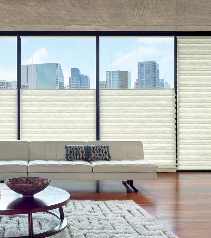 condo with floor to ceiling windows covered with roman shades in downtown Austin TX