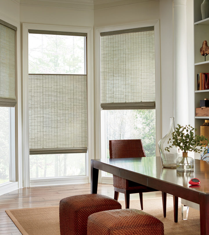 top down bottom up shades covering three windows in a beige dining room