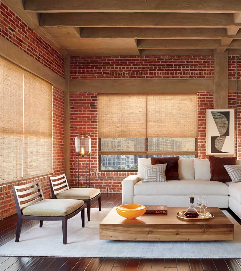 exposed brick loft with woven wooden window shades in Austin 78758