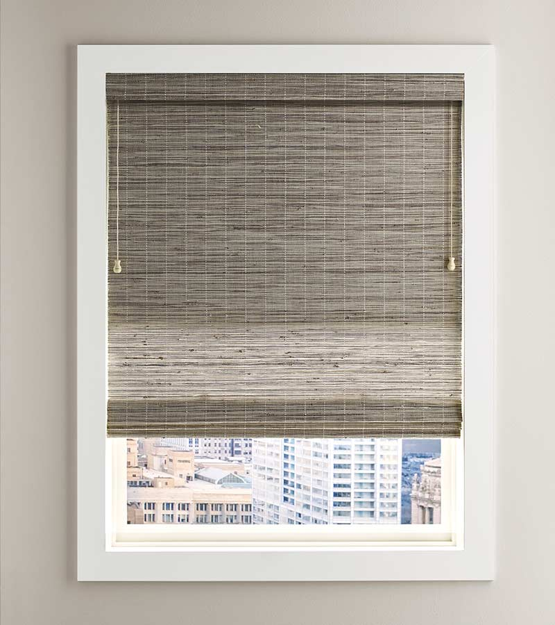 white framed window overlooking city with fabric shade in Austin 78758