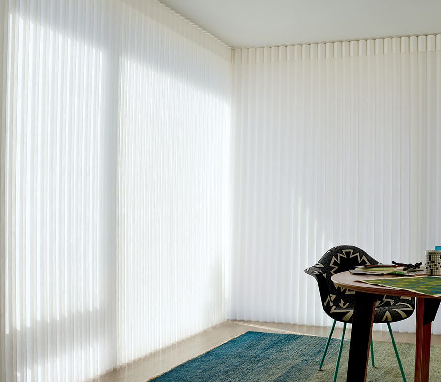 closed opaque vertical privacy sheers in home office