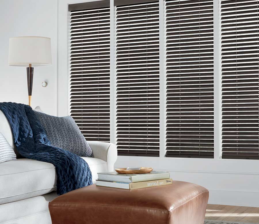white living room with brown wood blinds in Houston TX