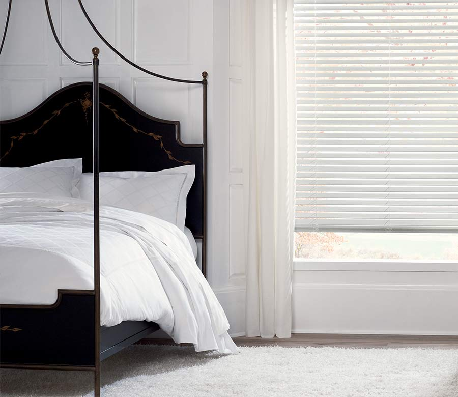 minimalist white bedroom with white wood blinds