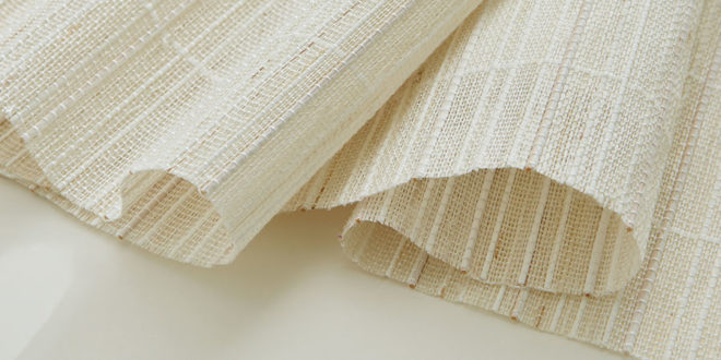 white woven window shades with natural fibers and variating feel