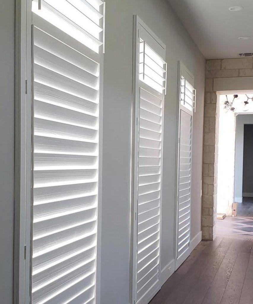 white hardwood shutter in Austin, TX hallway